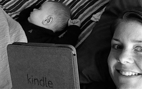 Coach Grause #whsreads her kindle with her kid.