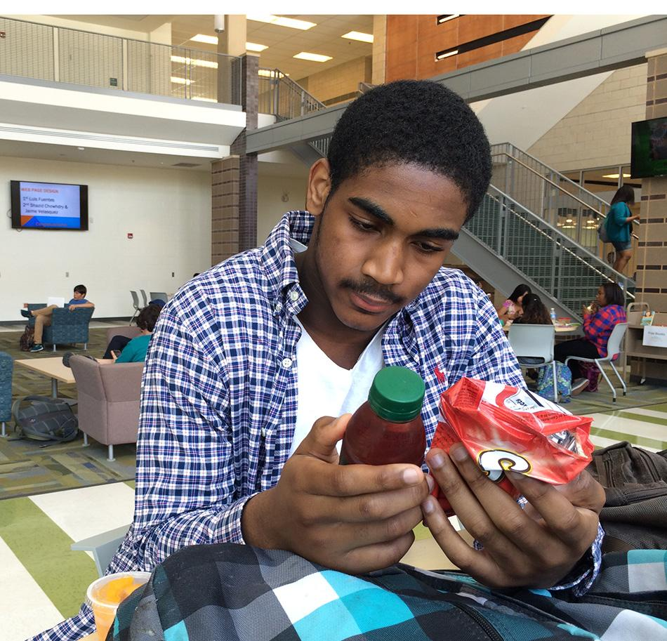 Junior Evan Ross looks at what his lunch is made of during...lunch.