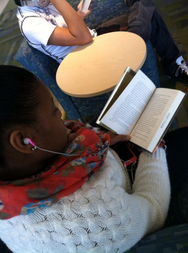 Junior Alyse Oliver listens to her favorite song while starting a new favorite book in Town Hall.