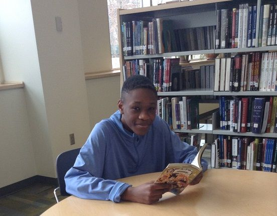 Chris Oluh '17 reads during lunch.