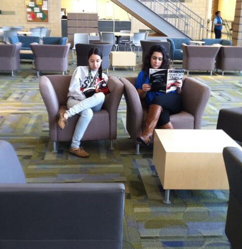 Senior Stephanie Gomez and Junior Nilofar Tokhi relax and read in Town Hall between lunches.
