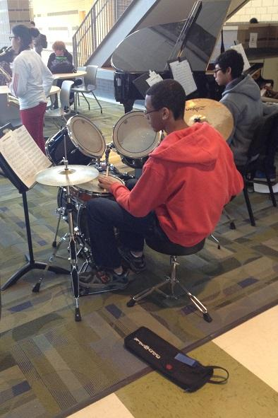 Malcolm Taylor '15 reads music notes at an impromptu Second Lunch Concert the day before winter break.