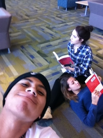 Cara Poythress '15 and Kailee Blailock '16 read their new library books in Town Hall. Jesus Enriquez-Hernandez '14 takes the opportunity to photo bomb the scene.