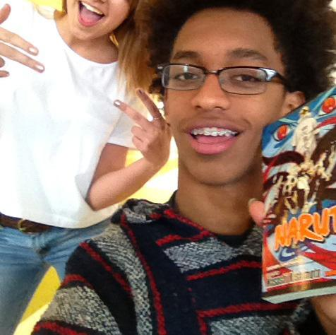 Sophomore Jimmy H. is excited about his new Manga novel. Kailee takes the opportunity to photo bomb the scene.
