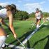Freshman Meghan Anderson and sophomore Liz Tiernan are both on the 2014 JV Field Hockey team. They warm up with slap shots before a home game.