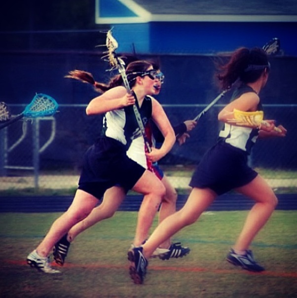 Madeline+is+on+the+attack+during+a+lacrosse+game.