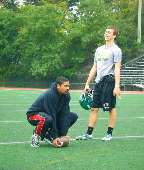 Coach Hogwood and Ryan Alston 14 talk during practice.