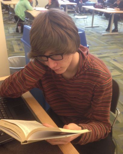 Junior Nick Epperson sits down to a good book in the Library during Warriors' Period.