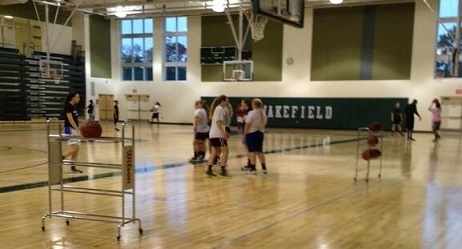 The varsity girls' basketball team looks spectacular hooping it up in our new gym.