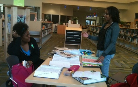 Sara Coleman '14 and Melliana Mulugeta '15 talk about the workload for upperclassmen as the library starts to close.