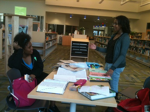 Sara Coleman 14 and Melliana Mulugeta 15 talk about the workload for upperclassmen as the library starts to close.