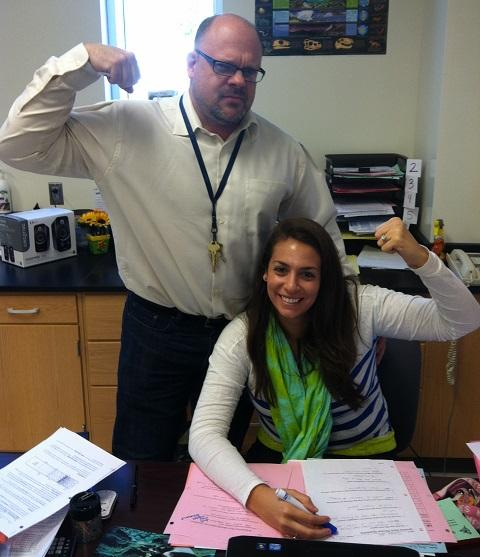 Mr. Campbell and Ms. Ruvel flex for the camera.