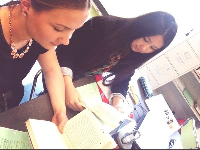 Luiza and Roxi take a #whsreads #selfie during reading time in Journalism class.
