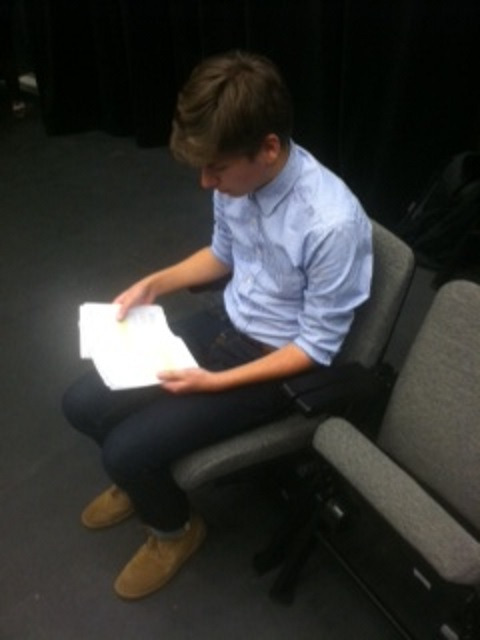 Rafael Lopez '17 studies his lines for the upcoming play.