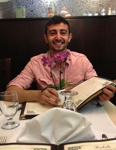 Senior Mehdi Huseynov reads the menu at an Afghan restaurant while on a date with his girlfriend, Senior Madeline Brophy.