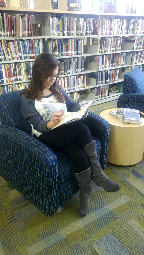 Lena Mobin '14 reads during lunch in one of the many comfy chairs in the library.