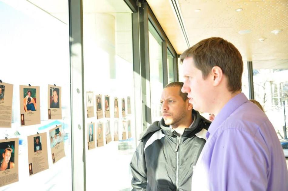 Coach Bentley and Coach W look at pictures of people who have passed on from drug abuse.