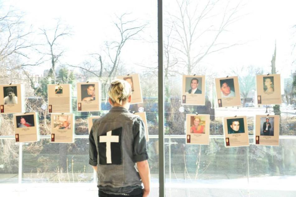 Christian Ward '16 looks at the faces of people who have lost their lives to drug abuse.