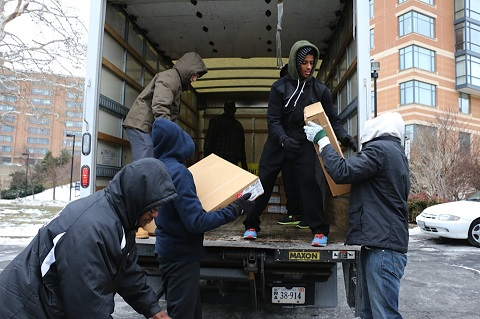 The team helps unload packaged good for community members without abundant access to food.