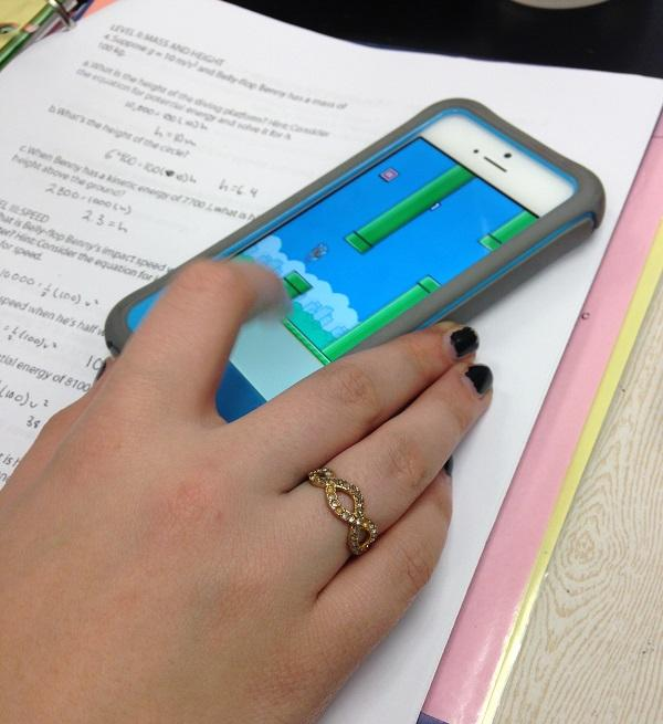 A+student+plays+Flappy+Bird+in+class.+It+is+addictive.