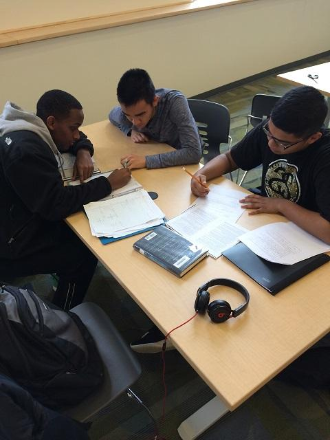 Seniors+Mohammed+Hussain%2C+Natnael+Wendifraw%2C+and+Annvar+Sarbanov+have+picked+the+library%2C+with+its+high+windows+and+comfortable+seating%2C+as+the+place+to+do+their+homework.+