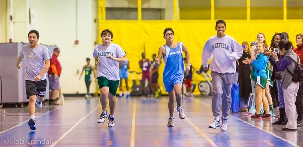 The 55-meter sprint during indoor track meet at Thomas Jefferson Middle School, Friday night, January 24, 2014. (L-R): Huan Vuong, James Crandall, Will Waddell, Nicholas Jones.