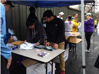 Seniors Adith Barua and Sofia Navas checked in participants on the day of the race.
