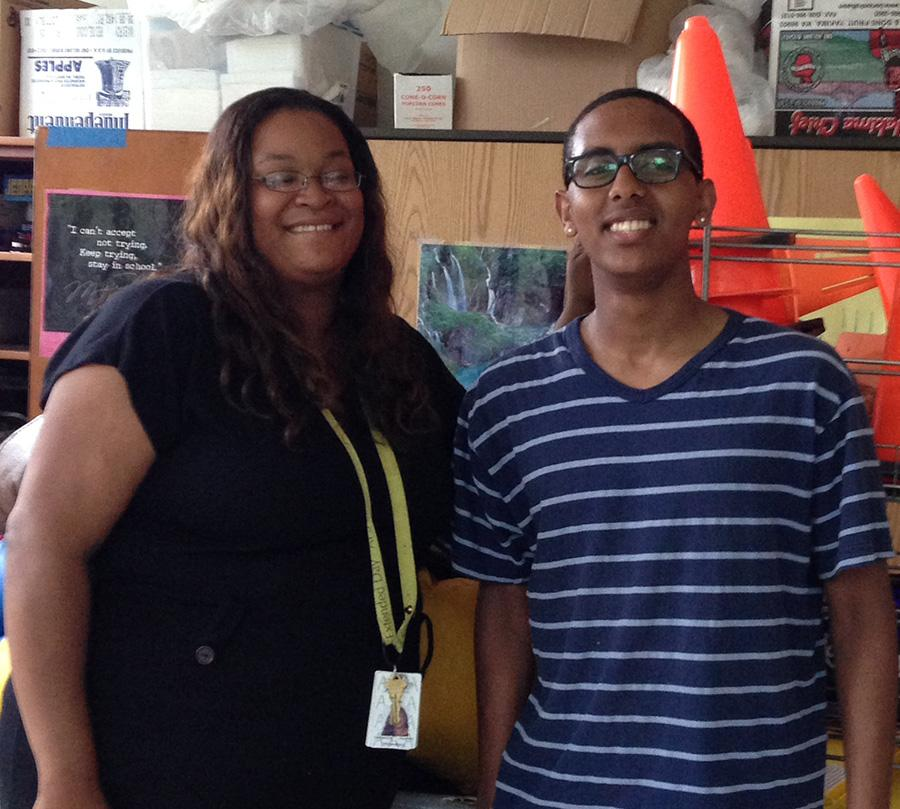 Ms. Martin and Solomon pose for the camera as they reminisce about his time in the program.
