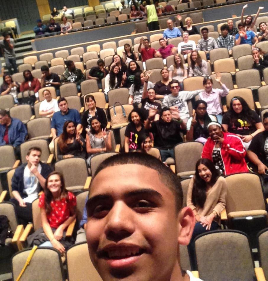 Senior+Anthony+Lopez+takes+a+%23selfie+as+the+audience+enters+the+auditorium.