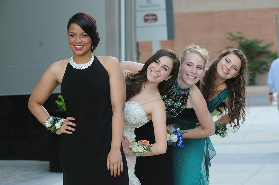 The ladies lean in with anticipation for prom night 2014.