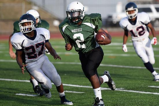 8th grade running back Rodney Lee picks up yards for the Warriors.