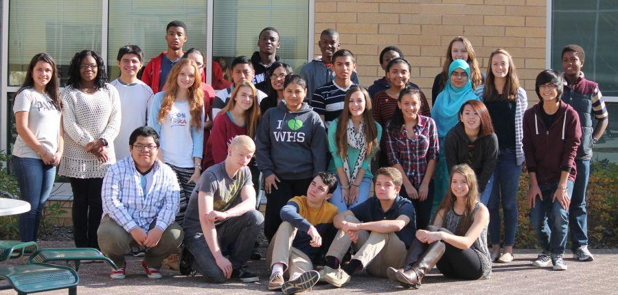 The September Students of the Month gather in the courtyard for their photo op.