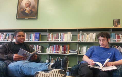Seniors Moses Washington and Sean Kinney leisurely read in the History section of the library.