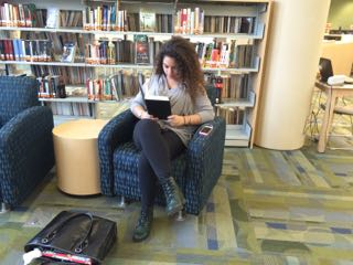 Senior Sara Najah gets some reading time in before class starts.