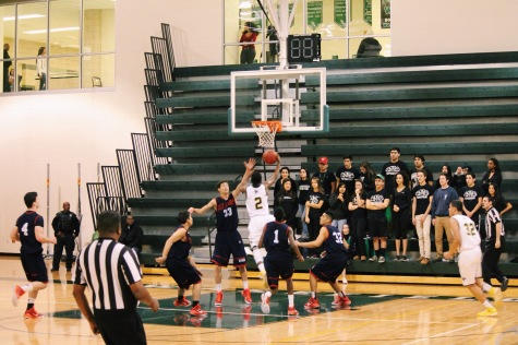 Sophomore Alan Treakle goes in for a layup.