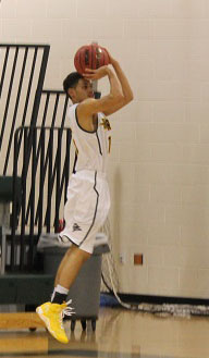 Senior Jordan Allen gets ready to make a 3 pointer.