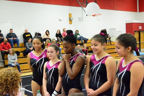 Wakefield's gymnasts team talks to the judges before a meet.