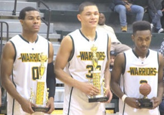 (Wakefield players receive their trophies) All-tournament players Marqua Walton  and Dominique Tham and tourney MVP Alan Treakle on center court.