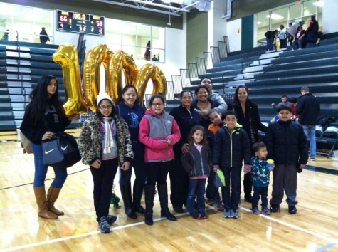 The Tham family gathered up after the win over Hayfield  and in celebration of Dominique Tham's 1,000 point.