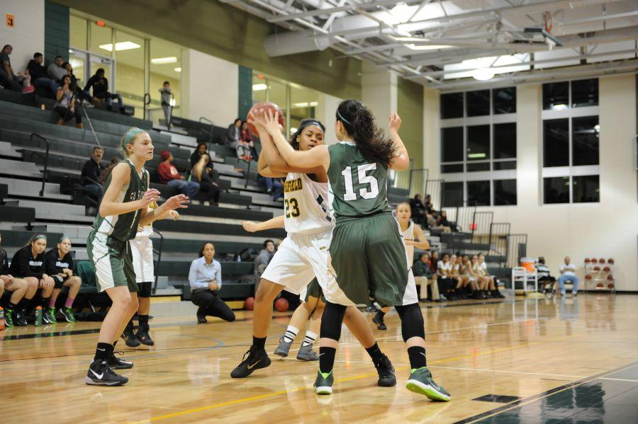 Senior Lyric Hatcher performs her famous pump fake move for a layup.