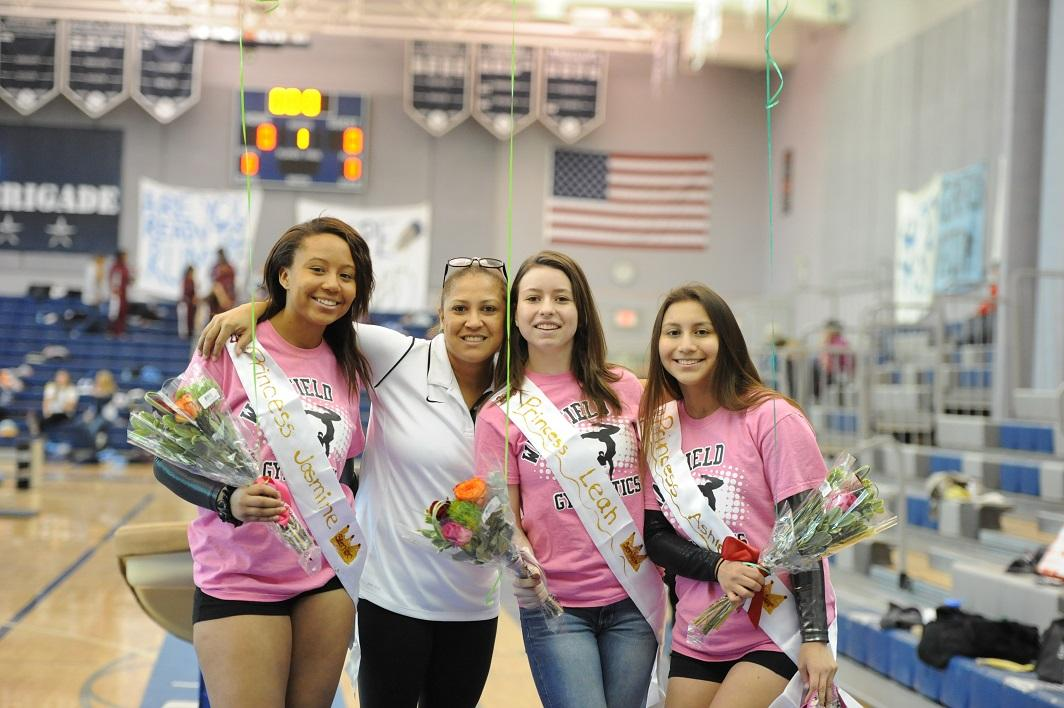 Seniors Jasmine Latney, Leah Corts, AShley Hidalgo and coach Nancy Nunez pose to commemorate Senior Night at the W-L meet.