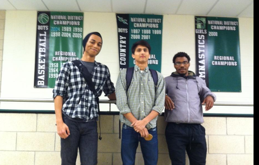 Miles, Hisham, and Ashanti smile in front of the banners before they leave for States. Congrats, boys!
