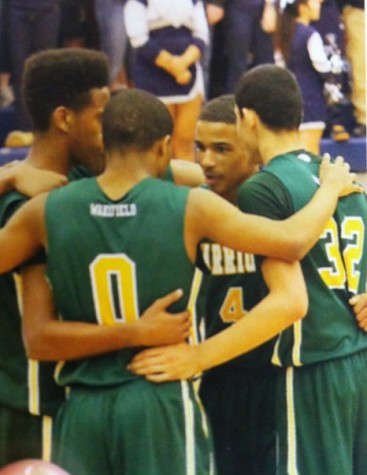 Khory huddles with members of the VBB team during his senior year. Domo and Marqua are sophomores in this picture!
