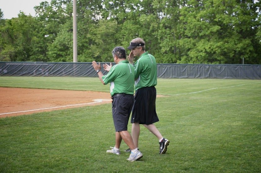 Coaches Bravo and DeFranco talk strategy as they head to the field.