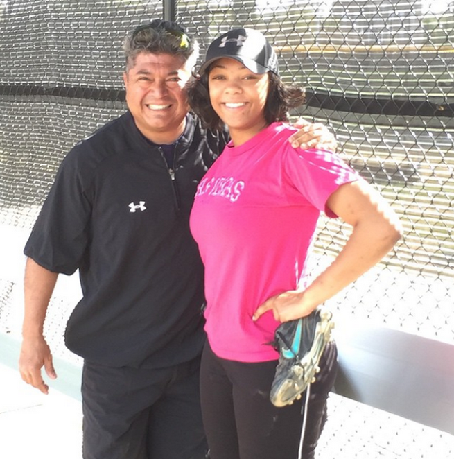 Coach Bravo and Jadah pose just before their win against Washington-Lee on April 30th, 8-6. #beatW-L