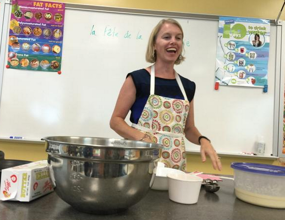 Ms. Haley talks about the perfect crepe batter with 4th period on Tuesday.