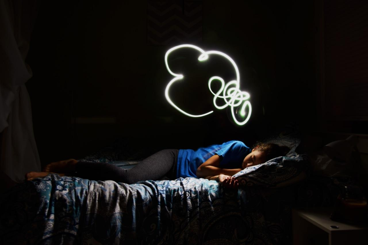"Madelyn's Wandering Imagination features a sleeping girl with a ""lit"" thought bubble."
