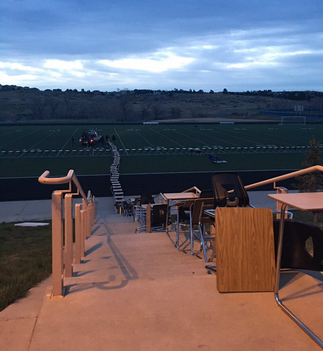 I guess that is one way to get out of classwork. Some seniors in Denver took all the desks out of the building and lined them up on the football field.