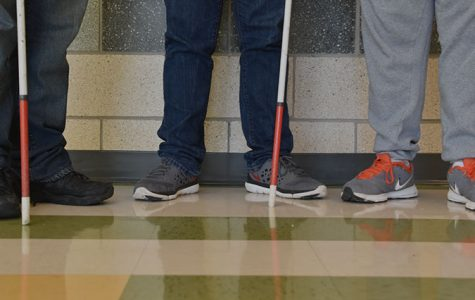 Sometimes it can be hard to tell triplets apart. Some use their shoe color to help differentiate.