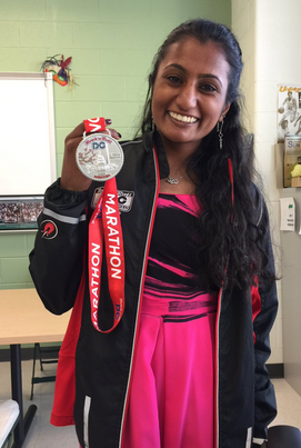 Lydia brought the marathon medal in on Senior Project presentation day.